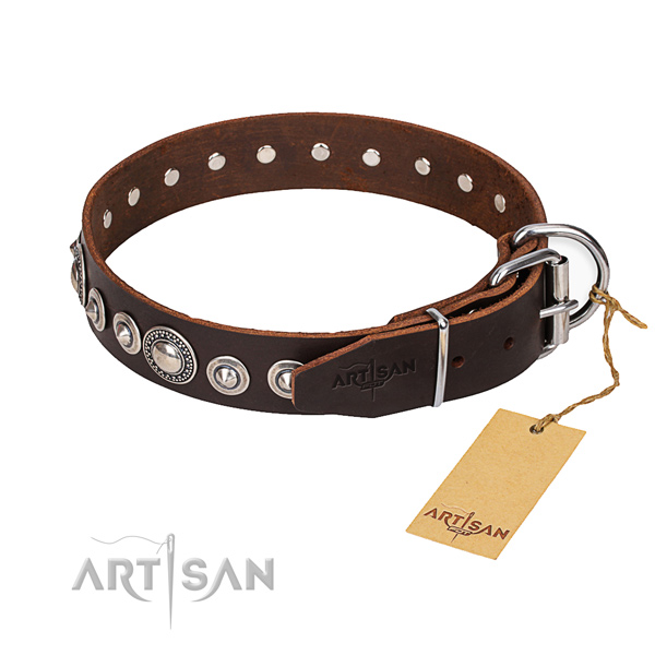 Full grain natural leather dog collar made of soft to touch material with reliable buckle